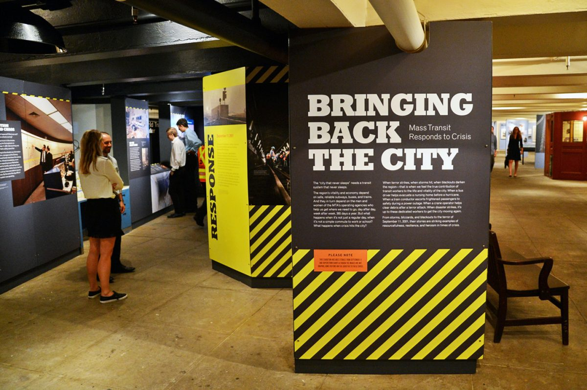 Visitors view Bringing Back the City gallery at the New York Transit Museum