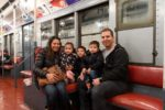 Family on vintage R1/9 train car at the New York Transit Museum